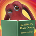 Rockford's Rock Opera reading a book